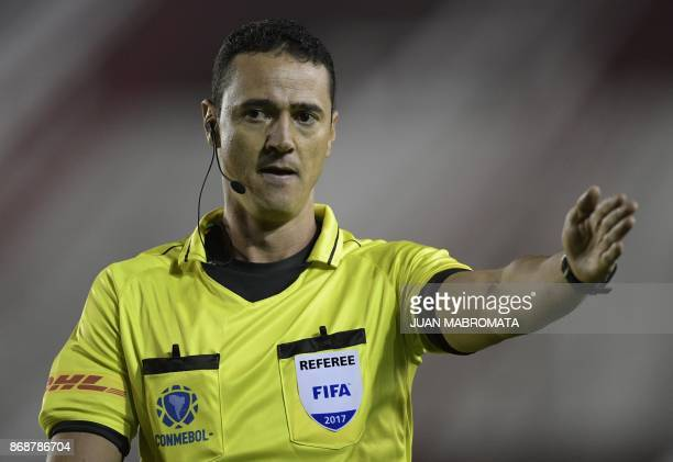Colombian referee Wilmar Roldan gestures during the Copa Libertadores semifinal first leg football match between Argentine teams Lanus and River...