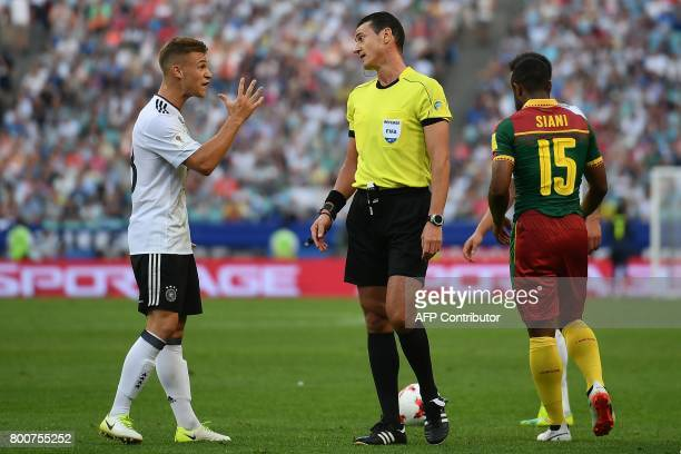 Colombian referee Wilmar Roldan speaks to Germany's defender Joshua Kimmich during the 2017 FIFA Confederations Cup group B football match between...