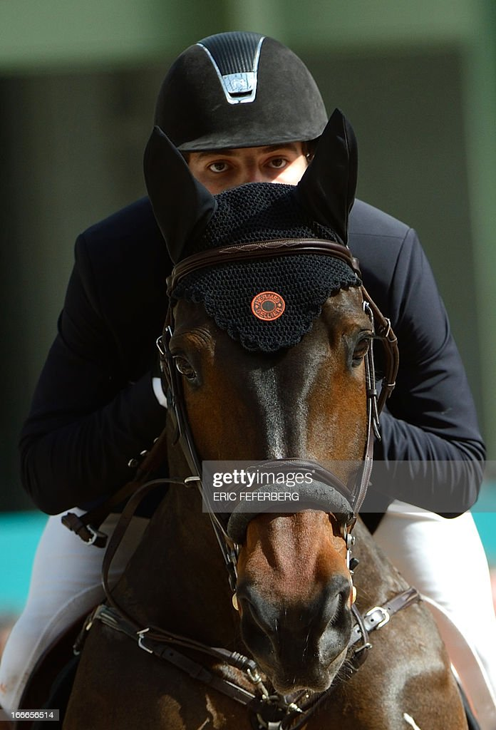 Colombian rider Daniel Bluman clears an obstacle on April 14, 2013 after winning the second place of the Grand Prix Hermes of Paris jumping event at the Grand Palais in Paris.