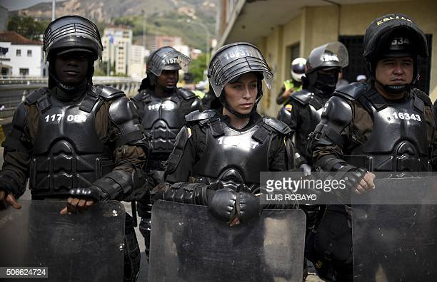 TOPSHOT Colombian riot police guard a march in Cali Colombia on January 24 2016 Thousands take to the streets to demand an increase in the minimum...