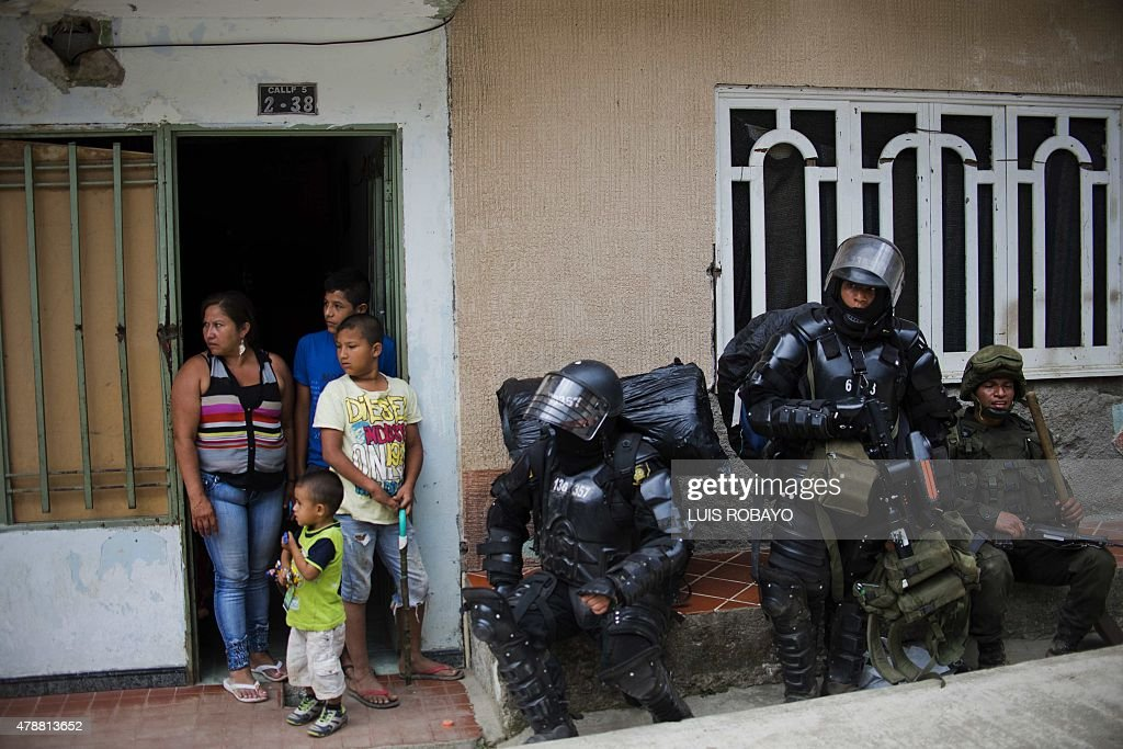 Colombian riot policemen and a soldier remain in a street of El Mango a rural area of the municipality of Argelia department of Cauca Colombia on...