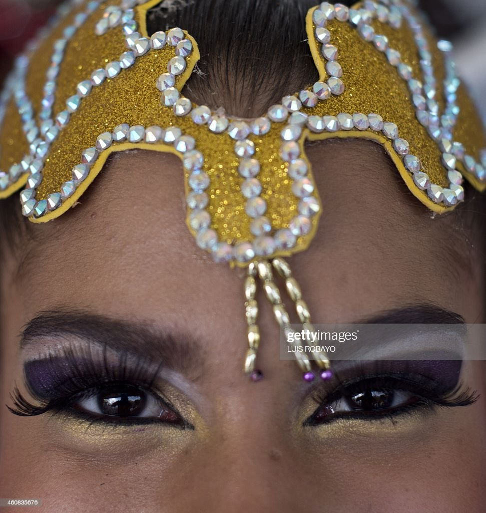 A Colombian salsa dancer poses for a photograph backstage before the beginning of the 'Salsodromo' parade which marks the start of the 57th Fair of...