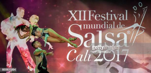 Colombian salsa dancers Diana Vallejo and Ivan Devia of 'Sensacion del swing' dance group participate in the Cabaret Couples category during the XII...