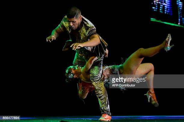 Colombian salsa dancers Emilse Montero and Jerson Rivas of 'Combinacion Rumbera' dance group participate in the Cabaret Couples category during the...