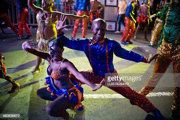 Colombian Salsa dancers perform in the 'Salsodromo' parade which marks the start of the 57th Fair of Cali on December 25 in the Colombian city of...