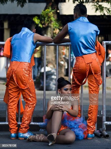 Colombian Salsa dancers rest in the backstage area before ...