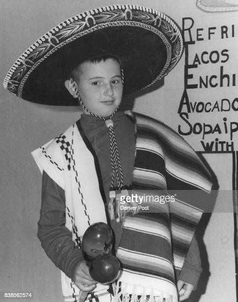 Colombian School in Fiesta Young Chris DeMatteo 4110 Decatur St looked the part with his colorful sombrero serape jacket and maracas ready for the...