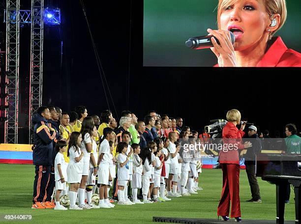 Colombian singer Funny Lu performs during the national anthem during the Colombia Farewell Ahead of FIFA World Cup Brazil 2014 event at Nemesio...