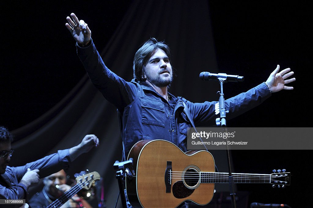 Colombian singer <a gi-track='captionPersonalityLinkClicked' href=/galleries/search?phrase=Juanes&family=editorial&specificpeople=202467 ng-click='$event.stopPropagation()'>Juanes</a> performs live at the Coliseo El Campin as part of his Unplugged Tour on November 27, 2012 in Bogota, Colombia.