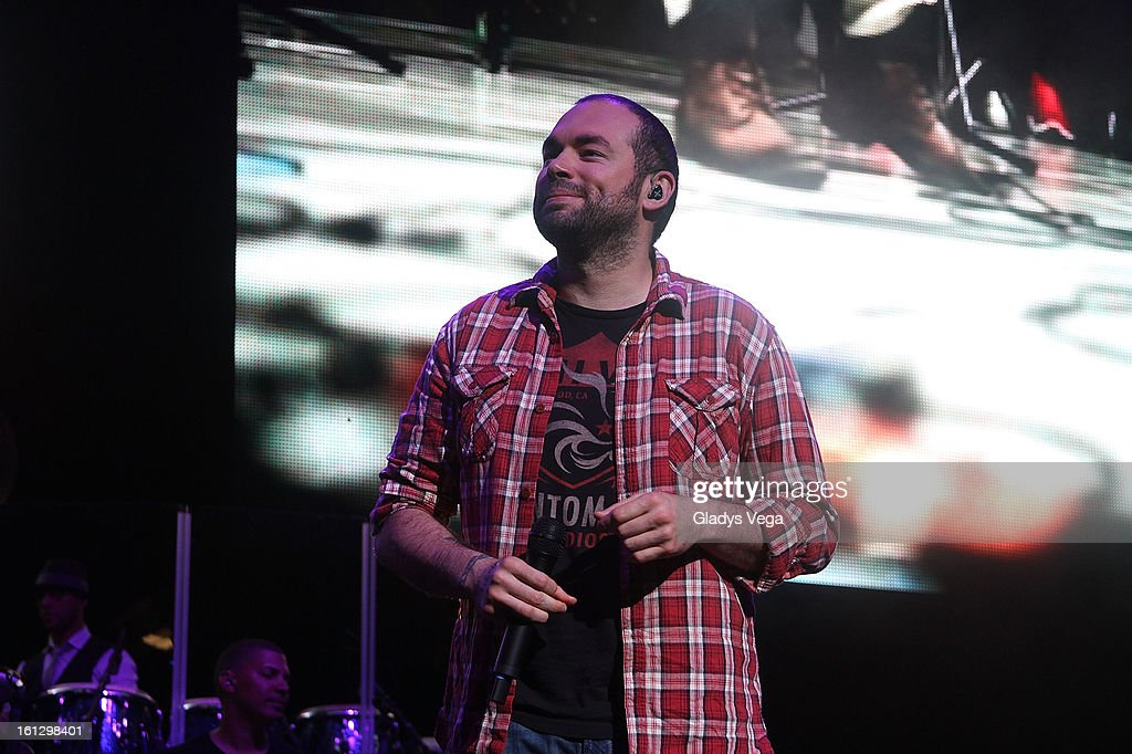 Colombian singer Santiago Cruz performs with Kany Garcia in her concert at Coliseo Jose M. Agrelot on February 9, 2013 in San Juan, Puerto Rico.