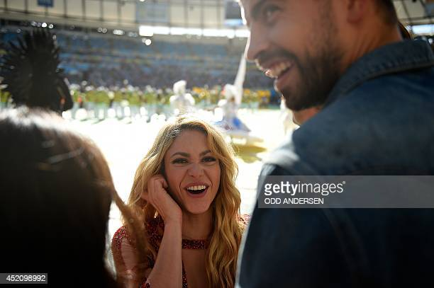 Colombian singer Shakira and her partner Barcelona's football player Gerard Pique smile during a closing ceremony ahead of the final football match...