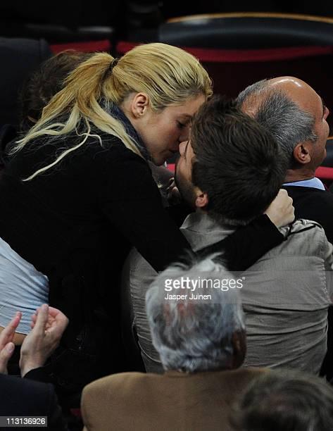 Colombian singer Shakira kisses Barcelona player Gerard Pique during the la Liga match between Barcelona and Osasuna at the Camp Nou stadium on April...