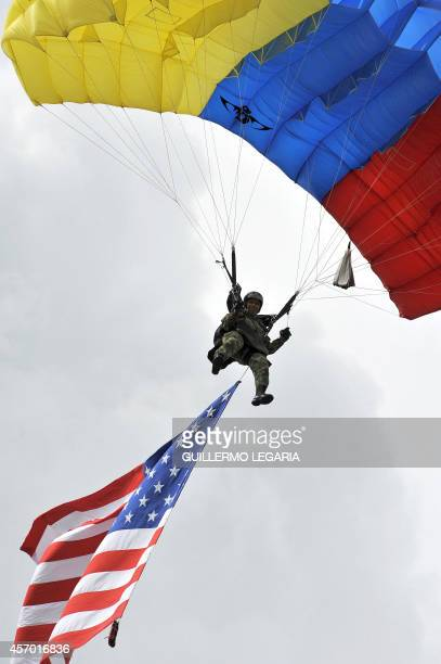 A Colombian soldier parachutes with an American flag during a military demo during the visit of US Secretary of Defense Chuck Hagel and Colombian...