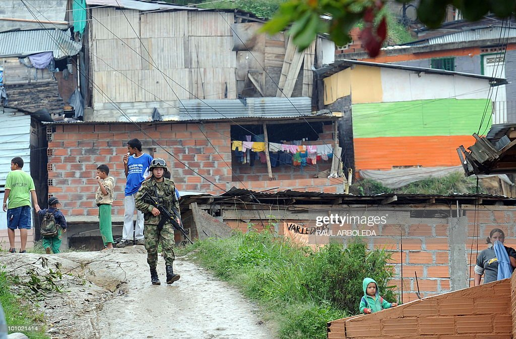 A Colombian soldier patrols the streets of Medellin, Antioquia department, Colombia on May 27, 2010. Colombia will hold presidential elections next May 30. AFP PHOTO/ Raul ARBOLEDA
