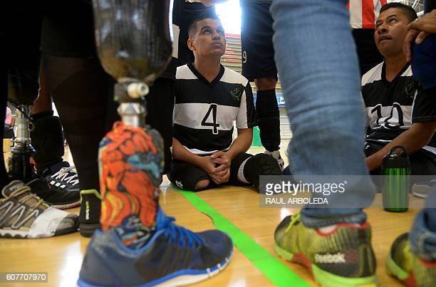 TOPSHOT Colombian soldiers and civilians victims of landmines wait to play in the sitting volleyball national championship final between the armed...