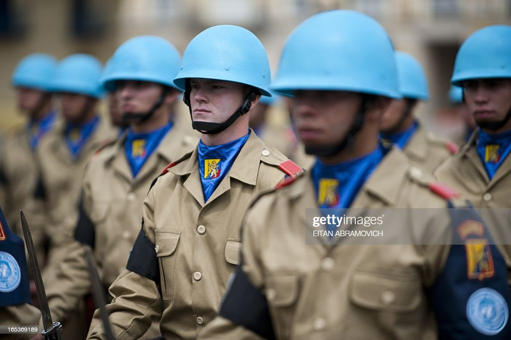 Colombian soldiers attend a military ceremony at Bolivar square in Bogota, Colombia, on April 03, 2013, to mark the 100th reshuffle of the Multinational Force and Observers (MFO) peacekeeping force overseeing the terms of the peace treaty between Egypt and Israel in the Sinai peninsula. AFP PHOTO/Eitan Abramovich