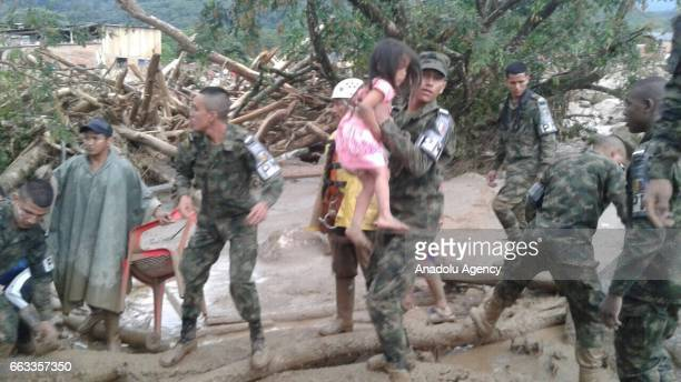 Colombian soldiers evacuate the victims of a deadly landslide that happened following heavy rains in Mocoa Putumayo Colombia on April 01 2017 At...