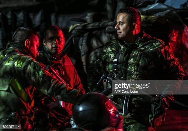 Colombian Soldiers gestures during search operations outside of 'La Guasca' mine in a rural area of Cucunuba Cundinamarca department Colombia on June...