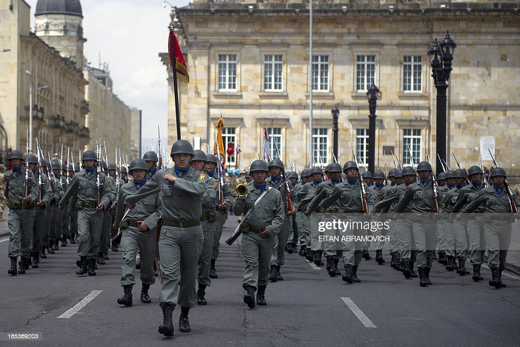 Colombian soldiers march during a military ceremony at Bolivar square in Bogota, Colombia, on April 03, 2013, to mark the 100th reshuffle of the Multinational Force and Observers (MFO) peacekeeping force overseeing the terms of the peace treaty between Egypt and Israel in the Sinai peninsula. AFP PHOTO/Eitan Abramovich