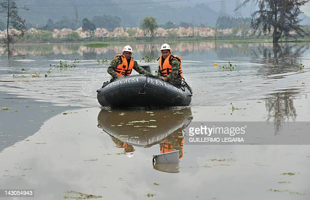 Colombian soldiers patrol a flooded farm in the municipality of Cota outskirts of Bogota Colombia on April 18 2012 Up to now the first rainy season...
