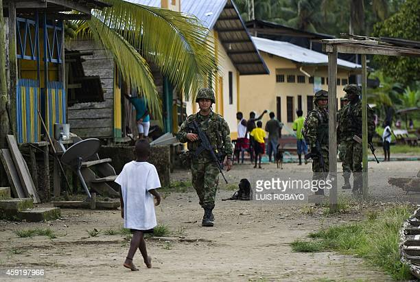 Colombian soldiers patrol the streets of Las Mercedes rural area of Quibdo Department of Choco Colombia on November 18 where Colombian General Ruben...