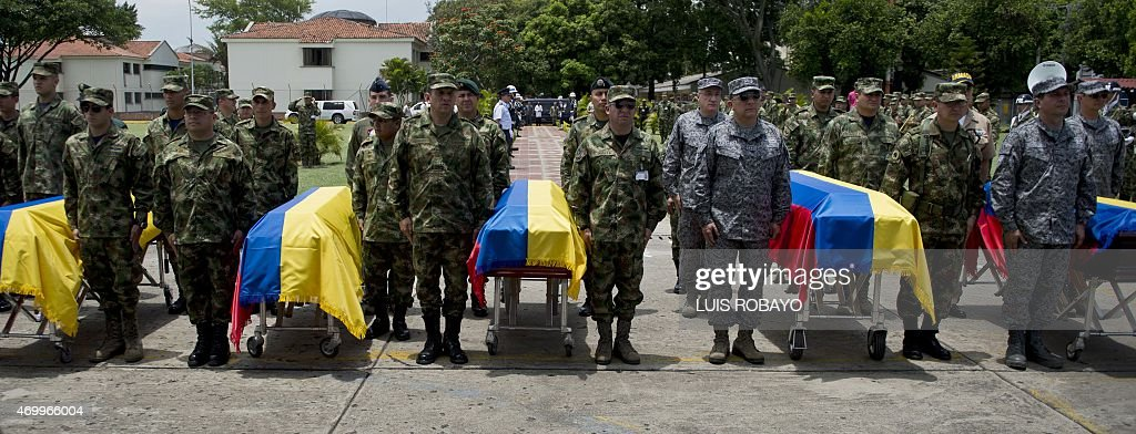 Colombian soldiers render funeral honours to six of their eleven comrades killed Wednesday in an attack by the Revolutionary Armed Forces of Colombia...