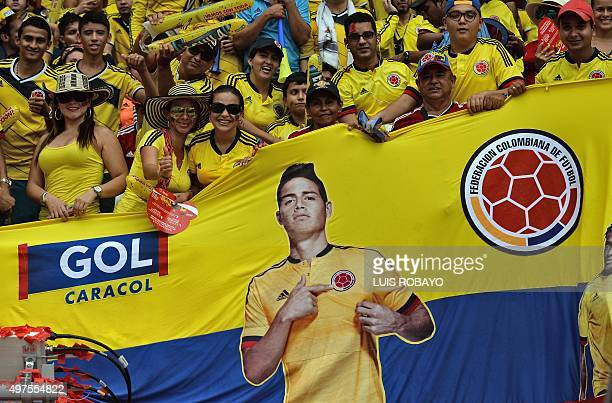 Colombian supporters cheer for their team with a flag depicting Colombian player James Rodriguez before the FIFA World Cup Russia 2018 qualifier...