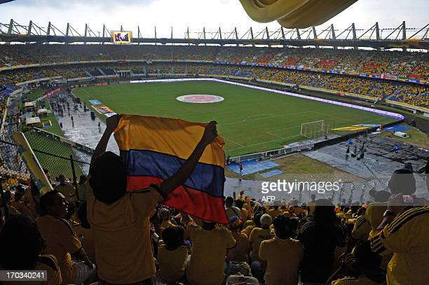 Colombian supporters cheer their team before the Colombia vs Peru FIFA World Cup Brazil 2014 South American qualifier football match at the...