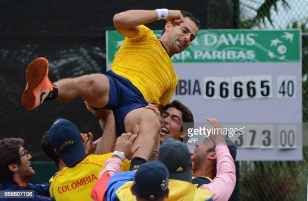 Colombian tennis player Santiago Giraldo celebrates his win over Chile's Christian Garin in their Davis Cup match in Medellin Colombia on April 9...
