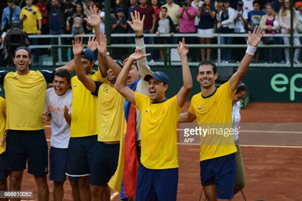 Colombian tennis player Santiago Giraldo celebrates with his team his win over Chile's Christian Garin in their Davis Cup match in Medellin Colombia...