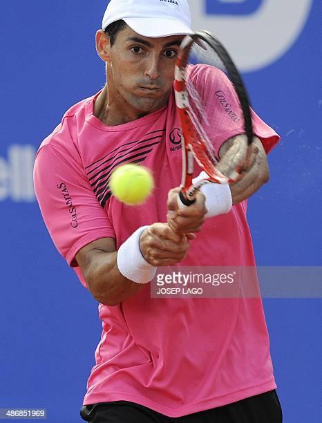 Colombian tennis player Santiago Giraldo returns the ball to Spanish tennis player Nicolas Almagro during the ATP Barcelona Open 'Conde de Godo'...