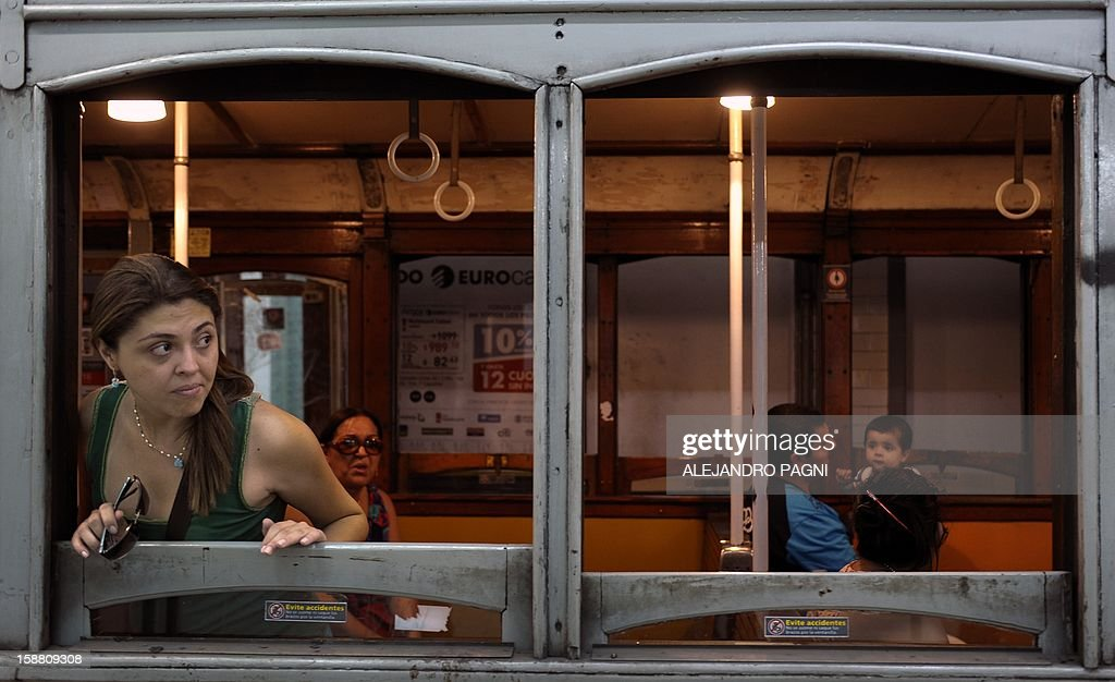Colombian tourist waits in one of the historic wagons of La Brugeoise of the subway Line A which is expected to be close soon following a decision by city mayor Mauricio Macri to replace the fleet with Chinese-made wagons, in Buenos Aires, on December 29, 2012. Line A was the first subway line to work in the southern hemisphere and its trains are among the ten oldest still working daily. The La Brugeoise wagons were constructed between 1912 and 1919 by La Brugeoise et Nicaise et Delcuve in Belgium.