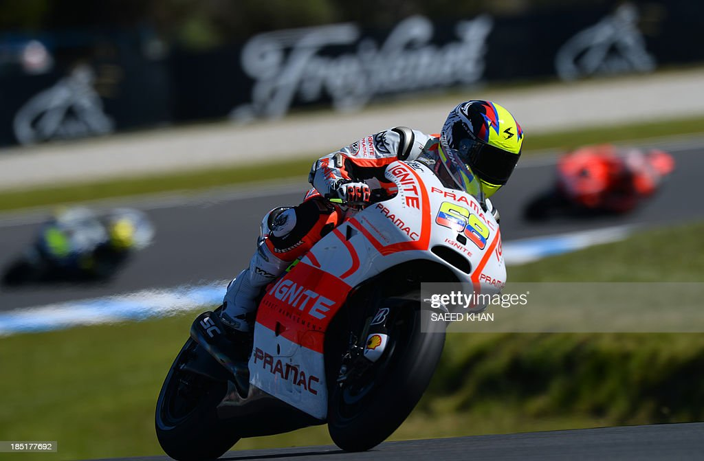 Colombian Yonny Hernandez rides during the second practice session of the Australian MotoGP Grand Prix at Phillip Island on October 18, 2013. AFP PHOTO/ Saeed KHAN USE