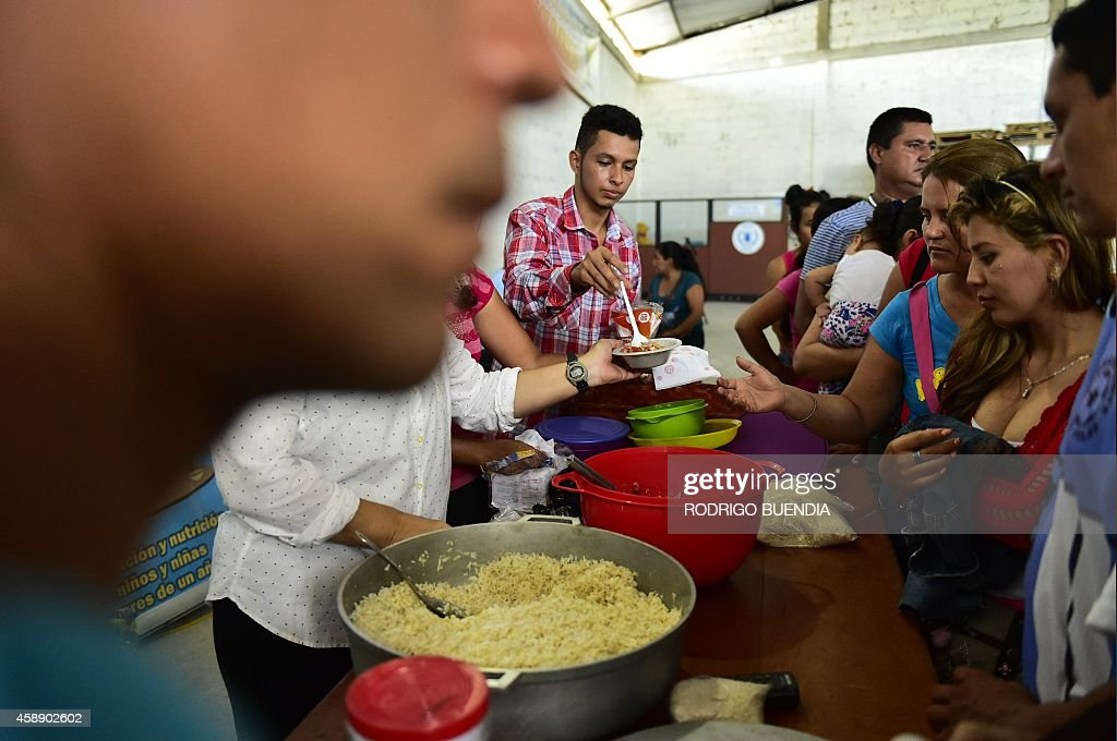Colombians displaced by violence in their country try a meal following a nutrition conference by officials from the World Food Programme in Lago...