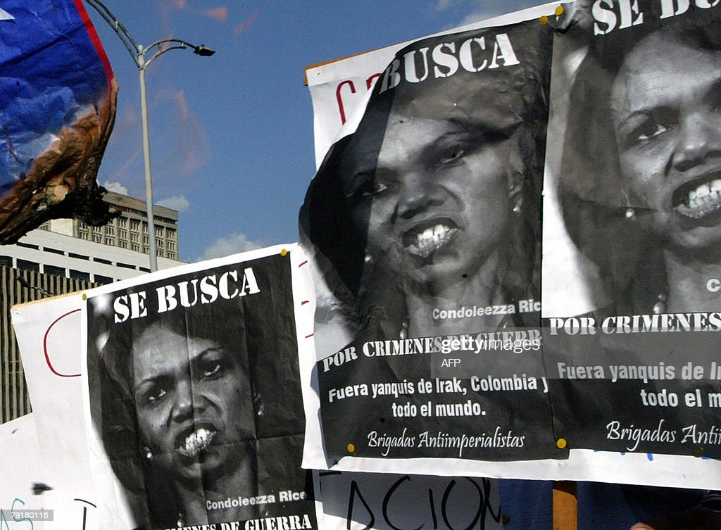 Colombians hold signs as they demonstrate against the visit of US Secretary of State Condoleezza Rice 23 January 2008 in Medellin, Antioquia department, Colombia. Rice will arrive to Colombia Thursday for a 24-hour official visit. The signs read 'Wanted, Condoleezza Rice for war crimes. Yakees out of Irak, Colombia and all the world. Anti imperialist brigade'. AFP PHOTO/Raul ARBOLEDA