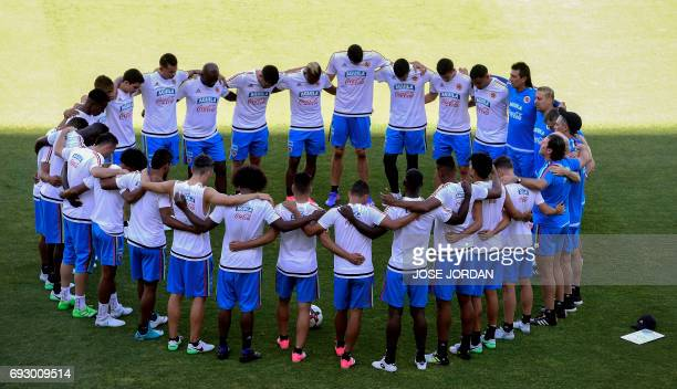 Colombian's players huddle during a training session at the New Condomina stadium in Murcia on June 6 2017 on the eve of their friendly match against...