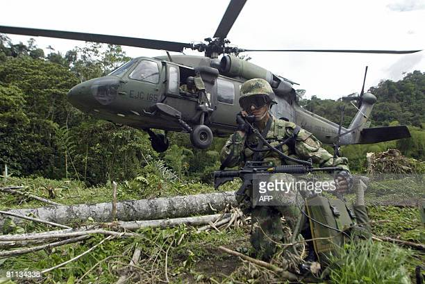 Colombians soldiers arrive in the jungle on the banks of the river Nulpe Tumaco in Colombia on May 17 a municipality situated fourteen kilometres...