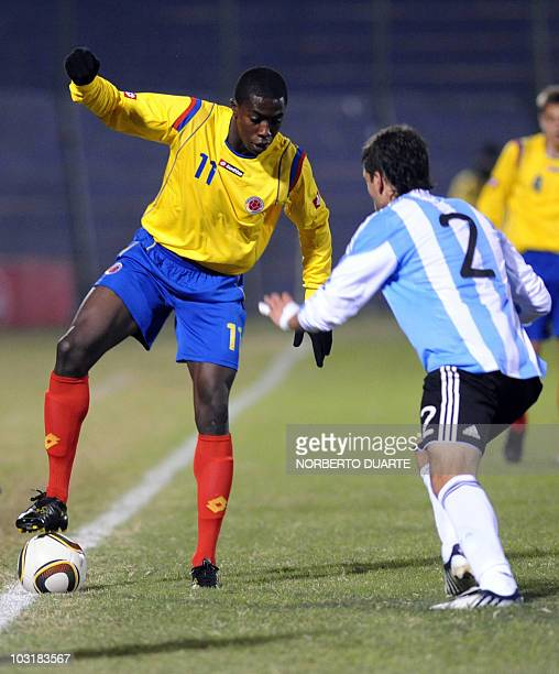 Colombia's Adolfo Valencia fights for the ball with Argentina's Martin Nervo during their Under20 tournament football match in Asuncion on July 31...