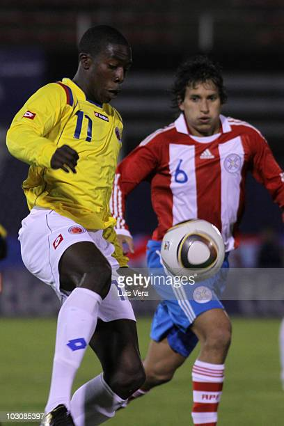 Colombia's Adolfo Valencia vies for the ball with Paraguay's Marcos Gimenez during their match as part of Sub 20 Mc Donalds Cup Latinamerican...