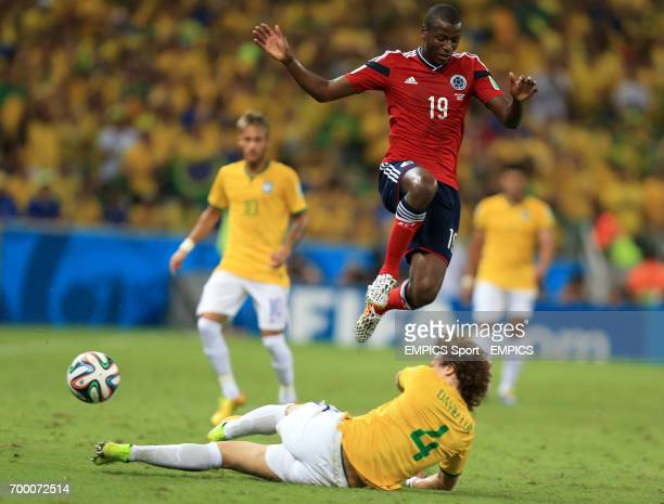 Colombia's Adrian Ramos and Brazil's David Luiz battle for the ball during the quarter final match at the Estadio Castelao Fortaleza