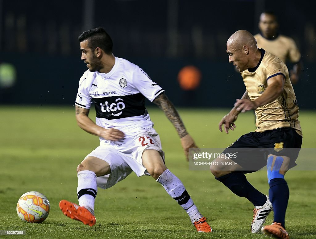 Colombia's AguIlas Doradas player Vladimir Marin vies for the ball with Paraguay's Olimpia player Ariel Nunez during their Copa Sudamericana football...