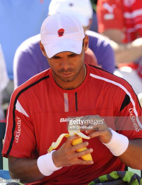 Colombia's Alejandro Falla eats a banana as he plays with Poland's Lukasz Kubot during their men's third round match in the French Open tennis...
