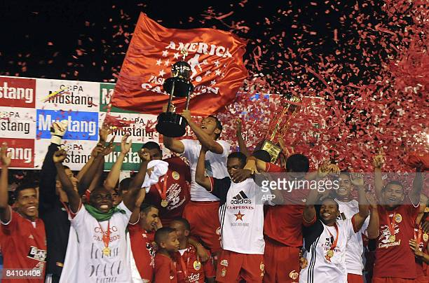Colombia's America de Cali players celebrate after defeating Deportivo Medellin during the Colombian league tournament final match at Pascual...