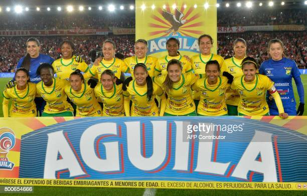 Colombia's Atletico Huila team players pose before their Women's Football League championship final match against Independiente Santa Fe at El Campin...