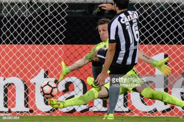 Colombia's Atletico Nacional goalkeeper Franco Armani saves the ball shot by Igor Rabello of Brazil's Botafogo during their Copa Libertadores 2017...