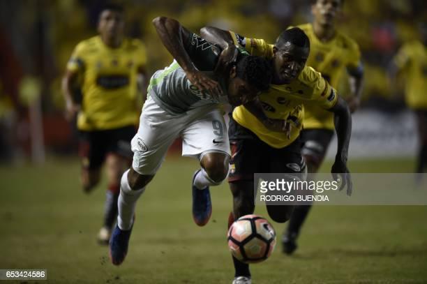 Colombia's Atletico Nacional Luis Carlos Ruiz vies for the ball with Ecuador's Barcelona Jefferson Mena during their Copa Libertadores football match...