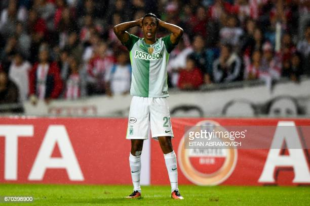 Colombia's Atletico Nacional midfielder Jhon Mosquera reacts during their Copa Libertadores group 1 football match against Argentina's Estudiantes de...