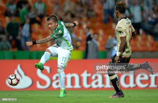 Colombia's Atletico Nacional player Dairo Moreno vies for the ball with Ecuador's Barcelona player Dario Aimar during the Copa Libertadores 2017...