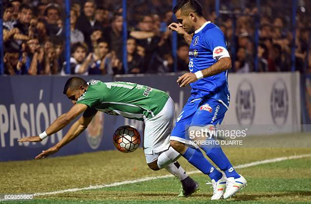 Colombia's Atletico Nacional player Farid Diaz vies for the ball with Paraguay's Sol de America player Marcos Melgarejo during their Copa...
