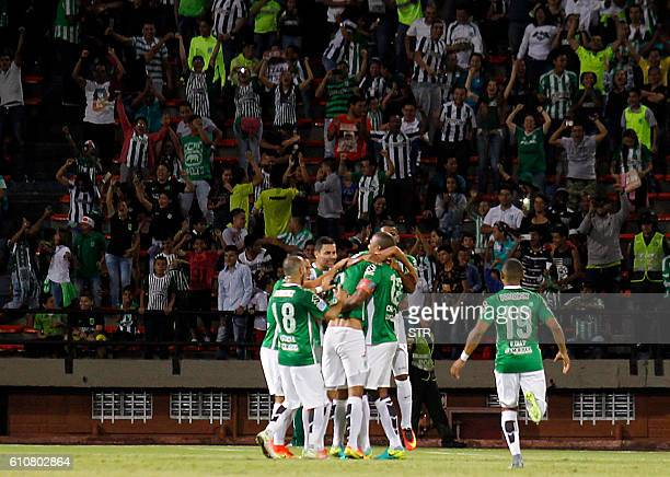 Colombia's Atletico Nacional players celebrate after scoring against Paraguay's Sol de America during their Copa Sudamericana 2016 football match...